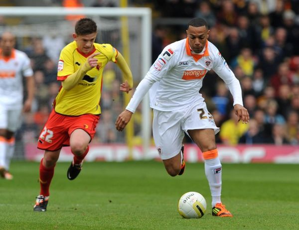 Watford's Sean Murray (left) and Blackpool's Matt Phillips battle for the ball