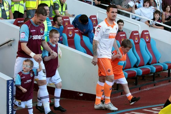 West Ham United captain Kevin Nolan and Blackpool captain Barry Ferguson lead out their teams at Upton Park