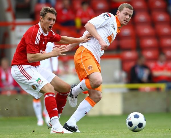 Wrexham's Martin Riley and Blackpool's Scott Roberston