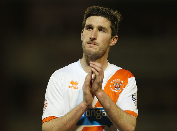 Blackpool's Chris Basham applauds the fans at the end of the game against Barnsley