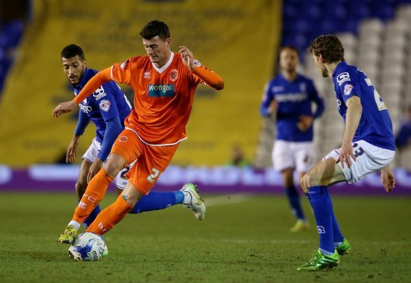 Blackpool's Gary Madine and Birmingham City's David Davies (left) in action