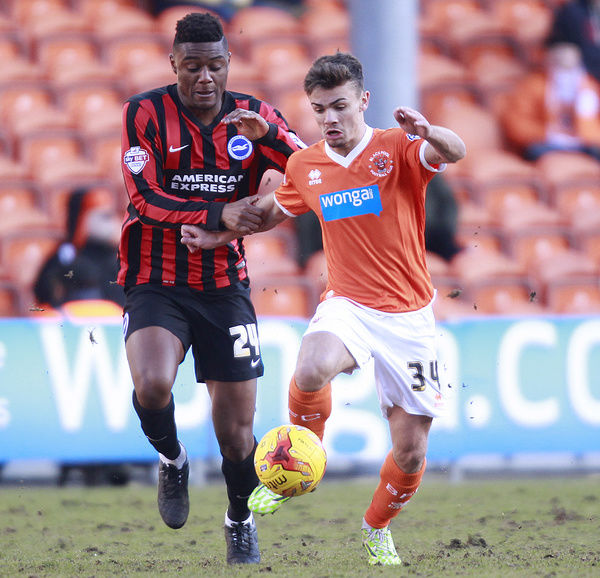 Blackpool's Dom Telford and Brighton & Hove Albion's Rohan Ince (left) battle for the ball