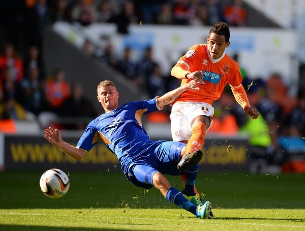 Thomas Ince of Blackpool hits the ball past Paul Konchesky of Leicester City to score only for the goal to be disallowed during the Sky Bet Football League Championship match between Blackpool and Leicester City at Bloomfield Road Stadium in Blackpool