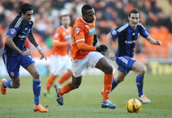 Blackpool's Ricardo Fuller and Middlesbrough's Rhys Williams and Dean Whitehead battle for the ball