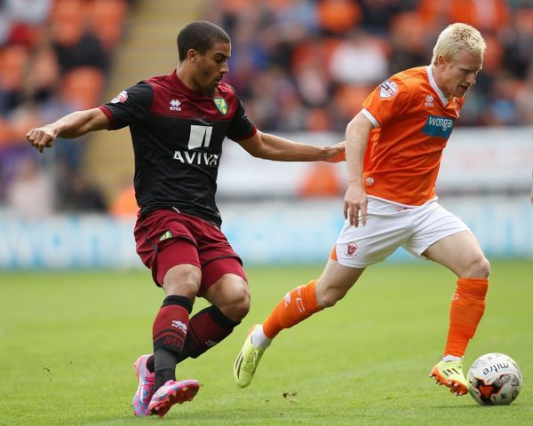 Blackpool's David Perkins and Norwich City's Lewis Grabban