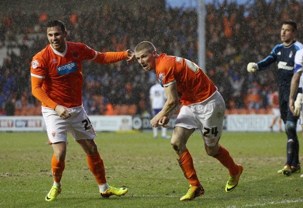 Blackpool's Andy Keogh celebrates scoring against Nottingham Forest with team mate David Goodwillie