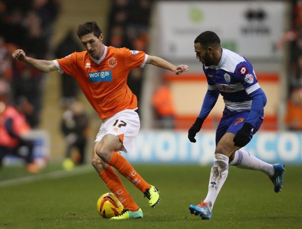 Blackpool's Chris Basham and Queens Park Rangers' goal scorer Matty Phillips