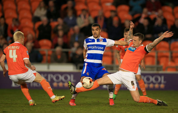 Blackpool's Peter Clarke (right) and David Perkins (left) take on Reading's Kwesi Appiah during the Sky Bet Championship match at Bloomfield Road, Blackpool. PRESS ASSOCIATION Photo. Picture date: Tuesday April 7, 2015. See PA story SOCCER Blackpool