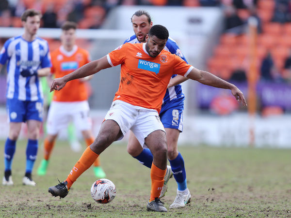Blackpool's Miles Addison and Sheffield Wednesday's Atdhe Nuhiu