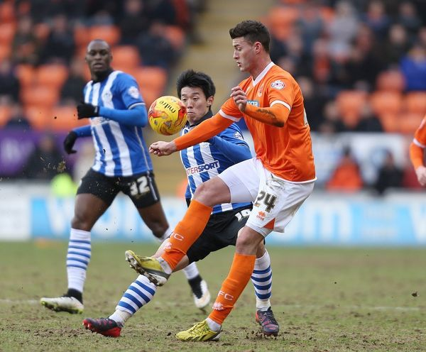 Blackpool's Gary Madine and Wigan Athletic's Kim Bo Kyung
