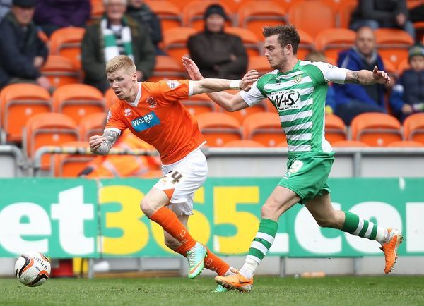 Blackpool's Andy Keogh and Yeovil Town's Joe Ralls battle for the ball