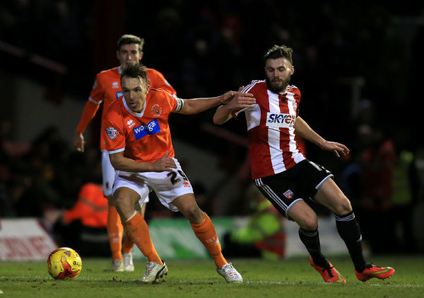 Blackpool's Anthony McMahon, (left) battle for the ball with Brentford's Stuart Dallas, (right)