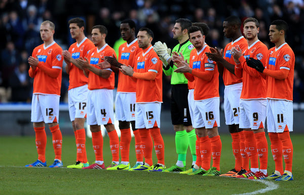 Blackpool's players observe a minutes applause in memory of Nelson Mandela