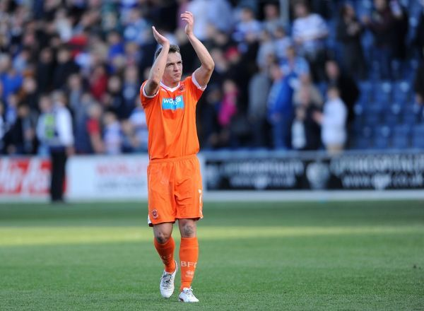 Blackpool's Chris Basham celebrates an away point after the final whistle