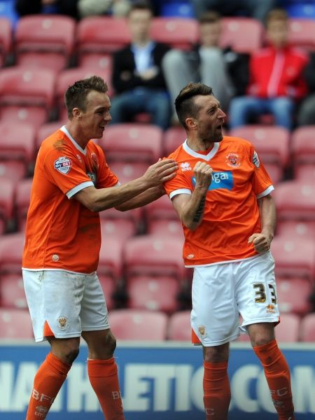 Blackpool's Stephen Dobbie (Right) celebrates with his team-mate Tony McMahon (Left) after he scores the second goal of the game for his side