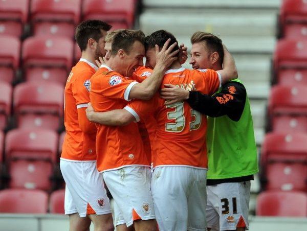 Blackpool's Stephen Dobbie (Centre) celebrates with his team-mate Tony McMahon (Left) after he scores the second goal of the game for his side