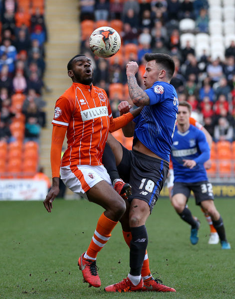 Blackpool's Hayden White battles for the ball with Bury's John O'Sullivan (right)