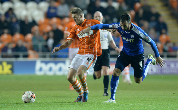 Blackpool's Jim McAlister battles for the ball with Chesterfield's Sam Hird