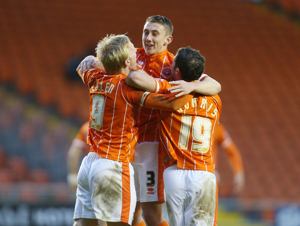 Blackpool's David Ferguson, Mark Cullen and David Norris celebrate the goal against Fleetwood Town