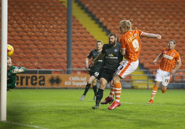 Blackpool's Mark Cullin scores the 1st goal against Peterborough United