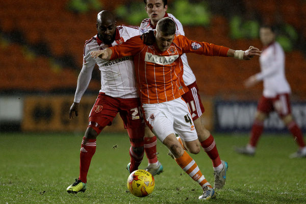 Blackpool's Jim McAlister battles for the ball with Sheffield United's Jamal Campbell-Ryce