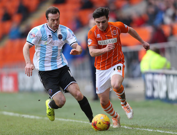 Blackpool's Jack Redshaw and Shrewsbury Town's Jack Grimmer battle for the ball