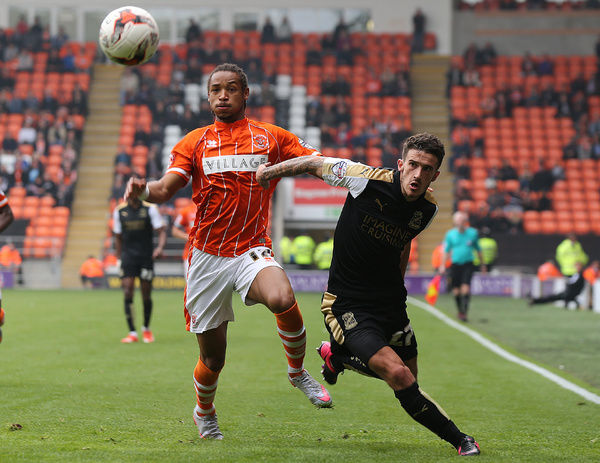 Blackpool's Kwame Thomas and Swindon Town's Bradley Barry