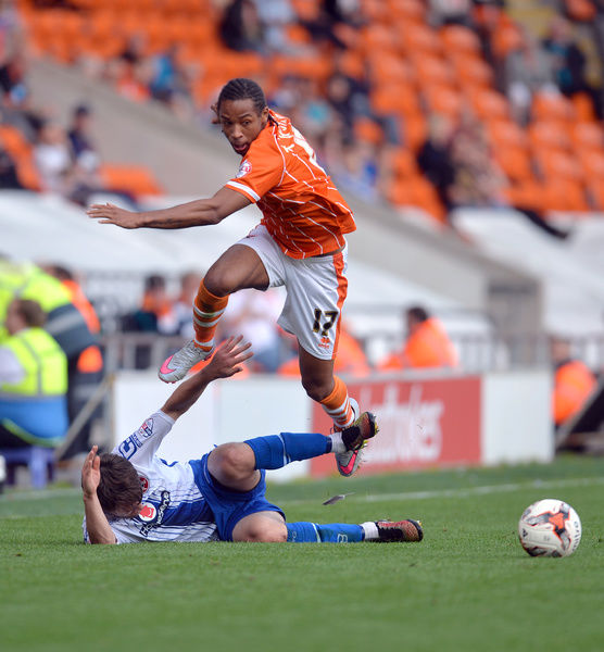 Blackpool's Kwame Thomas (top) and Walsall's Andy Taylor in action