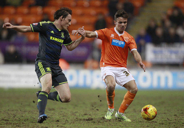 Blackpool's Dom Telford and Middlesbrough's Dean Whitehead (left) battle for the ball