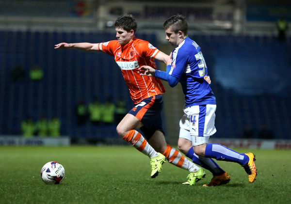 Chesterfield's Declan John (right) and Blackpool's Danny Philliskirk battle for the ball