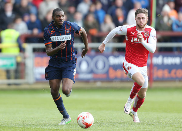 Fleetwood Town's Antoni Sarcevic and Blackpool's Hayden White (left)