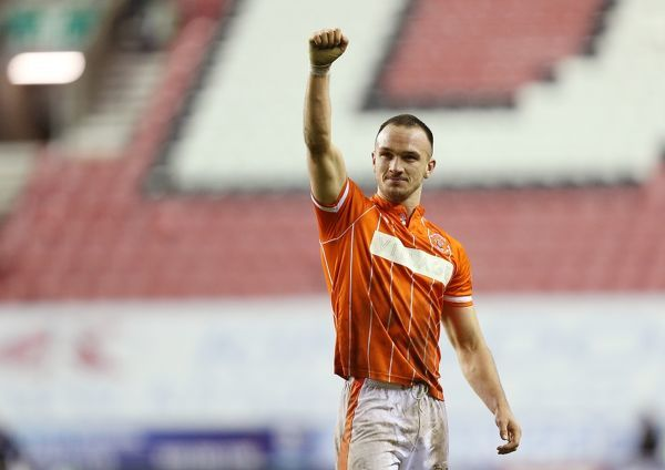 Blackpool's Tom Aldred celebrates at the end of the game against Wigan