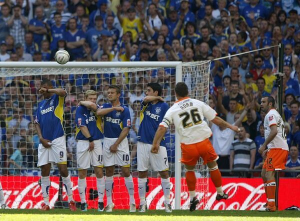Blackpool's Charlie Adam (number 26) scores their first goal from a free kick
