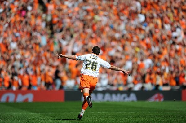Blackpool's Charlie Adam celebrates scoring his sides first goal of the game