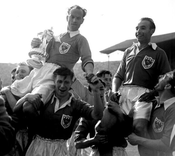 PA Library photo dated 2.5.1953 : Stanley Matthews while playing for Blackpool is chaired from the Wembley pitch with team captain Harry Johnson (holding the Cup) after his side claimed victory over Bolton by four goals to three in the FA Cup Final