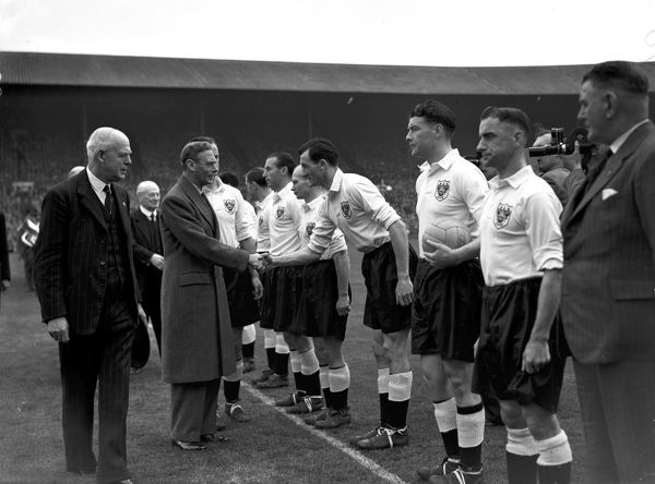 HM King George VI shakes hands with some of the Blackpool team before the FA Cup final at Wembley