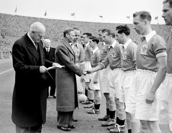 HRH King George VI being introduced to Stanley Matthews, and the rest of the Blackpool team, by Harry Johnston the Blackpool captain