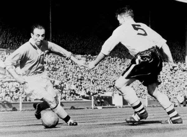 Stanley Matthews. Outside right Stanley Matthews cooly steers the ball