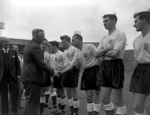 Stanley Matthews. The Duke of Norfolk shakes hands with England's Stanley Matthews