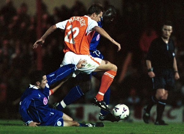 Blackpool's Neil McKenzie takes the ball over the top of the Leicester City's defence